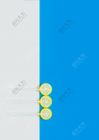 蓝色柠檬棒棒糖零食背景海报素材图片